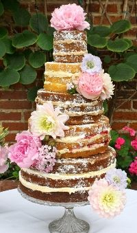 """The """"Naked Cake"""" trend is perfect for a rustic barn themed wedding!"""