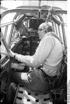 German gunner in the cockpit of a Bf 110 aircraft, somewhere in Russia, 1941-1945; Bf-110 is also referenced as Me-110 (same plane)