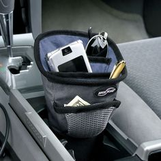 Car organizer that fits into your cup holder {The Container Store}.  Would like this.