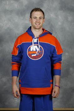 Defenseman Andrew MacDonald sporting a New York Islanders sweatshirt.