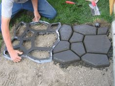 ~Cobble Stones~ For such project you can buy some concrete forms at Lowe's. Easy to work with. Mix a bag of concrete with water, add some color to it, place the concrete inside the frame and smooth it. Voila!!