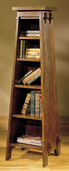 This book pedestal bears the mark of Roycroft, a community of craftspeople who created furniture, lighting, and home accessories in New York in the early 1900s.