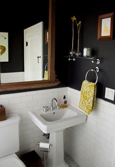 subway tile + pedestal sink + navy walls