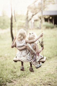 Sisters sharing a swing. <3