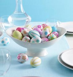For a fast centerpiece, fill a plain bowl with eggs decorated with craft stickers or rickrack. More Easter ideas: http://www.midwestliving.com/homes/entertaining/spring-centerpieces/page/9/0#