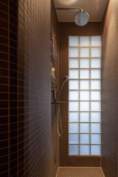 Karhard Architecture and Design, bathroom with black mosaic tiles and glass block | Remodelista
