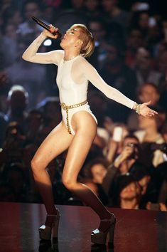 Miley Cyrus Tears Up Singing 'Wrecking Ball' In Skimpy EMAOutfit!