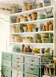 Love the old Dresser under the shelves!  Beautiful Storage Place!