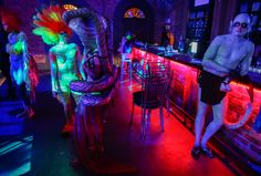 Models mingle at the bar prior to the Bodyspectra body painting event in Cape Town, South Africa on October 26, 2012. (Nic Bothma/EPA) #