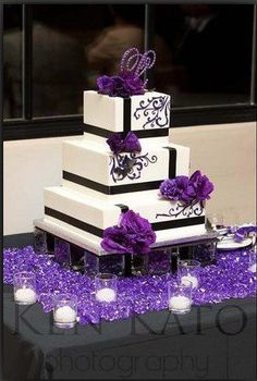 Purple wedding cake.. love the purple crystals around the candles