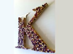 """Font: Times New Roman Bold. Wine cork letter decorated by customer. 22"""" 70.95"""