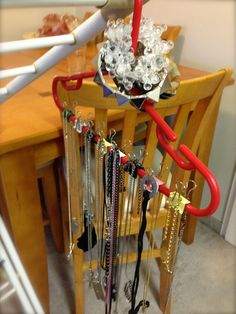 #JJNeepinFilms - Necklace storage on a budget. Kiddy hanger with mini binder clips. Cost? I dunno, depending on your clips, $5 - $10 ? But cost me nothing because I already had both items.
