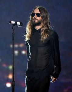 #JaredLeto of#ThirtySecondstoMars performs onstage at the 2014 #iHeartRadio Music Awards held at The Shrine Auditorium on May 1, 2014 in Los Angeles, California. Photo by Getty Images #longhair #hair #menshair #beard #aviator #avaiatorglasses