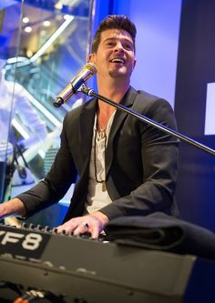 Hey, hey, hey. Robin Thicke does his thing behind the keys during a performance on March 25 in New York