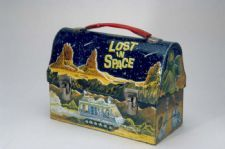 """Lost in Space"" Lunch Box: This lunch box features images from the television show ""Lost in Space,"" which ran from 1965-1968 on CBS. ""Lost in Space"" was originally named ""Space Family Robinson,"" and was a futuristic take on the Swiss Family Robinson."