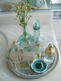 Pretty Perfume display for Vanity. I like the idea of using one similar color to set it all off.