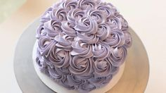 Rose cakes (or rosette cakes) are so easy to make. Learn how to make one with buttercream frosting using the #1M star tip by Wilton and a swirl of the wrist.
