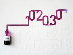 Ink calendar by Oscar Diaz. The ink will slowly color each day of the month as time passes by.