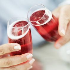 Faux Kir  A Kir is white wine with creme de cassis (a raspberry liqueur); a Kir royale replaces the white wine with champagne; and a Kir Normand or Kir Breton replaces it with hard cider. To make this sans alcohol, try this:   Ingredients:  1 tsp. raspberry syrup (available in coffee and gourmet stores) or grenadine  6 ounces sparkling cider, chilled  Garnish: fresh raspberries