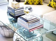 Sam Allen interiors.  Acrylic coffee table with poufs tucked underneath.  Love this look!