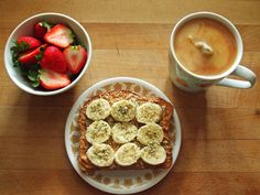 whole wheat toast with peanut butter, banana, & hemp hearts, sliced strawberries, and celestial seasonings morning thunder black tea with soy milk