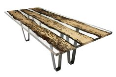 reclaimed wood in acrylic...cool. It's like a natural history museum encapsulated in your coffee table!