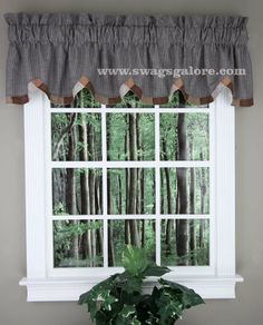 Harvest Ring Patchwork Valance, is a fully lined scalloped valance, accented with a patchwork trim. Main fabric is a muted blackish charcol grey, with muted white lines.  #Country #Kitchen #Curtains