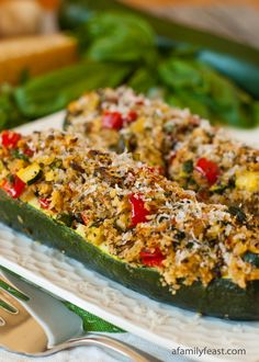Vegetarian Stuffed Zucchini - a delicious and super flavorful filling with vegetables, cheeses and Panko.  Great for a Meatless Monday meal or a side dish for roasted or grilled meats.