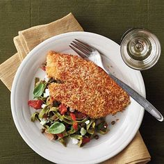 Crispy Oven-Baked Tilapia with Lemon-Tomato Fettucine | We love how the bright flavor of the pasta complements the panko-breaded tilapia. | SouthernLiving.com