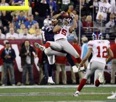 New York Giants over the New England Patriots (SuperBowl XLII).  On February 3, 2008, Eli Manning scrambled out of the grasp of the New England defenders and hurled a pass across the middle of the field.  David Tyree made an amazing catch by pinning the football to his helmet so it wouldn't hit the ground.  Not long after this catch, the Giants scored the winning touchdown.  Final score: 17-14.