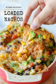 Loaded Nachos - Loaded with both refried and black beans, you definitely won't be missing the meat in these cheesy, vegetarian nachos!