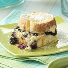 Baked Blueberry French Toast      24 slices day-old French bread (1/2 inch thick)     1 package (8 ounces) PHILADELPHIA® 1/3 Less Fat Cream Cheese Spread, cubed     2/3 cup fat-free milk     1/2 cup reduced-fat sour cream     1/2 cup fat-free plain yogurt     1/3 cup maple syrup     1 teaspoon vanilla extract     1 teaspoon ground nutmeg     1/2 teaspoon ground cinnamon     2 cups egg substitute     2 cups fresh or frozen blueberries     2 tablespoons confectioners' sugar