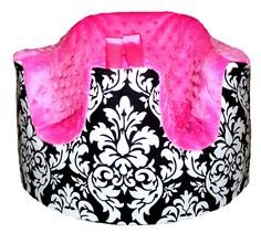 Bumbo chair cover, and it's so freaking cute. Love the added loops for toys to be attached and the pocket in back.  BoutiqueSweetCheeks