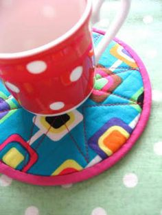 coasters made out of old CD's and fabric -- too cool!