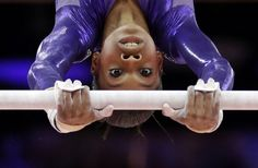 U.S. gymnast Gabrielle Douglas performs on the uneven bars during the Artistic Gymnastics women's qualification at the 2012 Summer Olympics, Sunday, July 29, 2012, in London. (AP Photo/Gregory Bull) Photo: Gregory Bull, Associated Press / SF