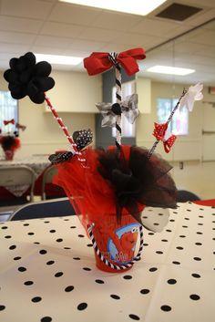 Elmo centerpieces for girl: elmo bucket with bows