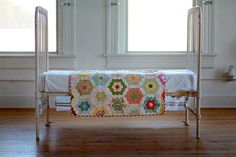 Flower Girl        hexie flower garden quilt.via Etsy