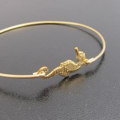 Seahorse Bangle Bracelet  Gold by FrostedWillow on Etsy, $16.95
