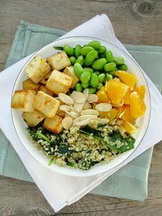 Citrus Protein Bowl w/ tofu, spinach, quinoa, edamame, almonds, orange, and an Asian orange dressing - http://www.vanilla-and-spice.com/2014/02/citrus-protein-bowl.html