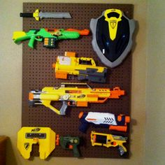 Peg board for toy guns in boy's room- This is going on my honey do list...only difference is ours will be painted.  We have so many guns & swords!