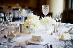 Collection Centerpiece of Mercury Glass Votive Pillars and White Floral Collection.  Fulton's on the River Wedding. Summer Jean Photography. Sweetchic Events. Larkspur.