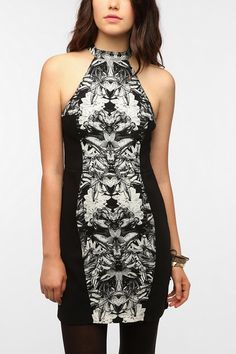 Rectangle- This dress is perfect for a rectangle body shape. The dress makes her look as if she has curves. The black on the outside of the design makes her look thin and curvy.