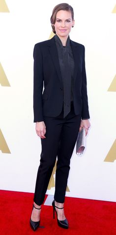 At the Academy's Hollywood Costume Luncheon, Hilary Swank gave her red carpet look a dapper twist and layered a sharp Saint Laurent suit over a neck-tie polka-dot blouse. Saint Laurent accessories, like her metallic clutch and Mary Jane platforms, a Melissa Kaye ring, and Graziela Gems onyx earrings completed her look.