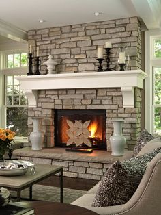 gorgeous fireplace with stone, from floor to ceiling