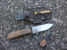 "RedEyedJack custom knives Spear Point Bushcraft knife. This bushcraft style spear point knife is made from American made 3/16"" file steel. 4"" blade, 8"" overall. Walnut handle scales, 3/16"" nickel silver pins. Brown custom Kydex sheath with matching Fero rod . Handmade in U.S.A. with pride. Find us on Facebook REJck RedEyedJack custom knives of Bonifay, Florida E-mail redeyedjackcustomknives@yahoo.com"
