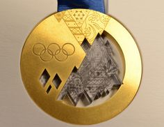 """Gold medals for Sochi games winners on February 15, 2014. This is the first anniversary of the day a small asteroid exploded over Chelyabinsk in Russia. Bits of meteorite fragments were incorporated into these special gold and chondrite medals. Mona Evans, """"Galactic Winter Games"""" http://www.bellaonline.com/articles/art182620.asp"""