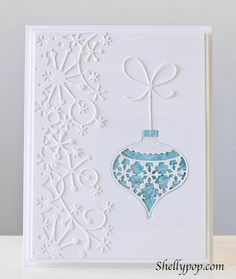 beautiful, almost all-white card...Memory Box ornament with bow and snowflake border...