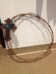 Barb wire cross wreath:-) I love this