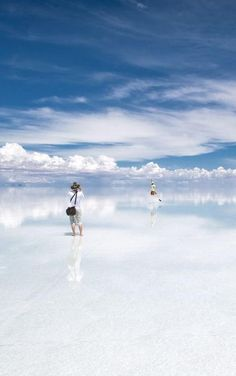 Salar de Uyuni is a magical place: When covered by water, the world's largest salt flat becomes a mirror, and anyone walking across it appears to be walking on clouds. Southwest Bolivia
