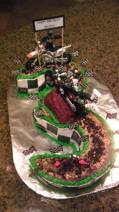 """Dirt bike cake I made. Chocolate frosting and graham crackers and Oreos to make """"dirt."""""""